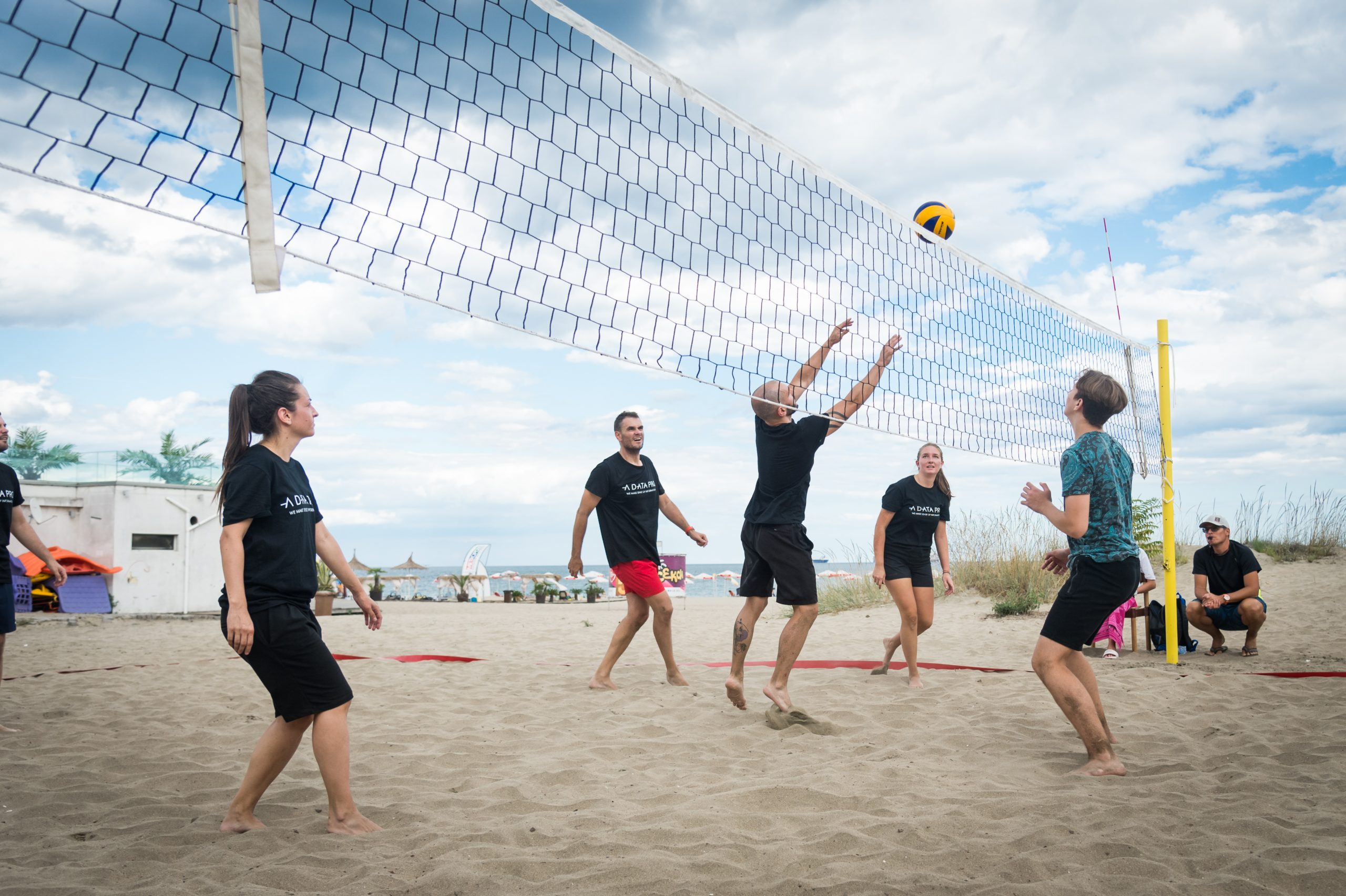 A Data Pro Team playing volleyball